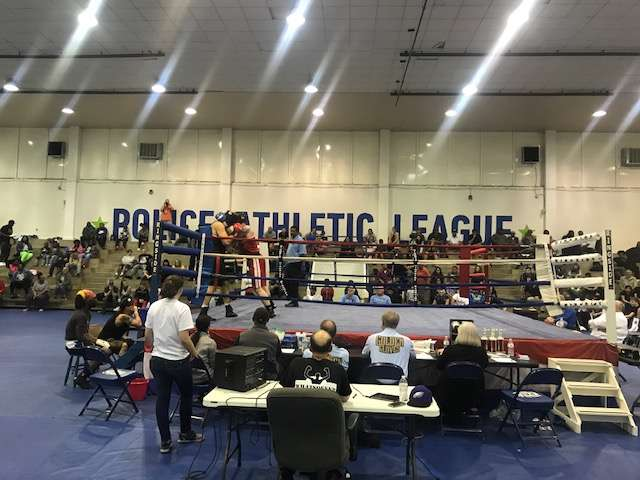 Boxers in the ring at KC PAL with a crowd looking on