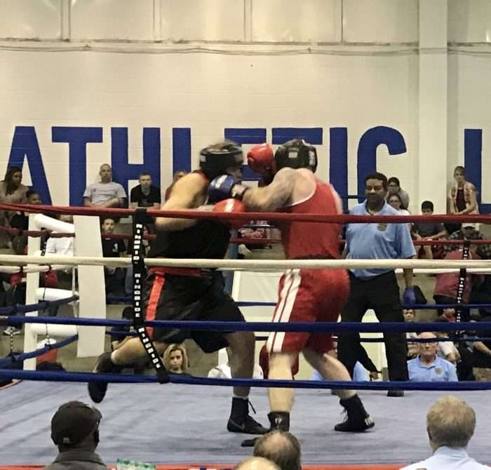 Boxers brawling in the ring as the crowd cheers them on at KC PAL